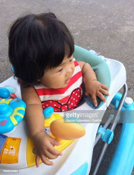 High Angle View Of Toddler In Baby Walker