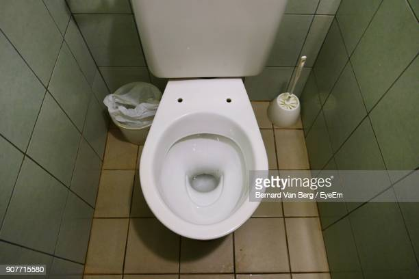 high angle view of toilet bowl in bathroom - toilet bowl stock photos and pictures