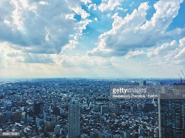 High Angle View Of Tokyo Cityscape Against Cloudy Sky