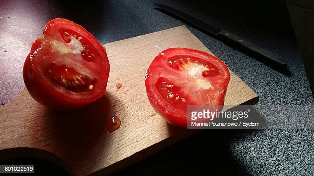 High Angle View Of Tomato Slices On Cutting Board