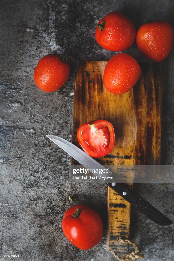 High Angle View Of Tomatoes And Cutting Board : Stock Photo