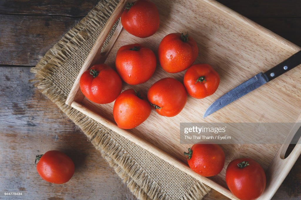 High Angle View Of Tomatoes In Container On Table : Stock Photo
