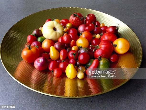 High Angle View Of Tomatoes In Plate On Table