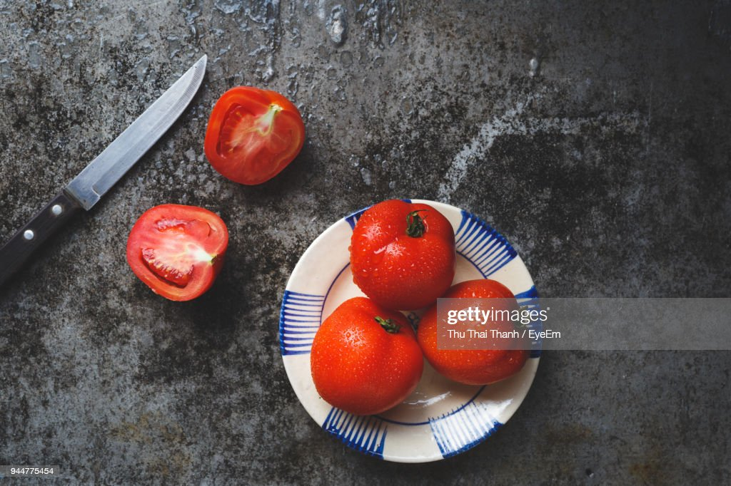 High Angle View Of Tomatoes In Plate : Stock Photo