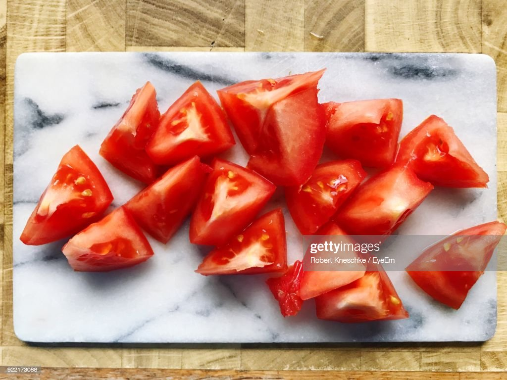 High Angle View Of Tomatoes On Cutting Board : Stock Photo