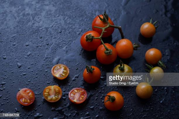 High Angle View Of Tomatoes On Wet Slate