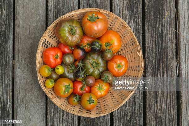 high angle view of tomatos in basket on table - cambridge new zealand stock pictures, royalty-free photos & images