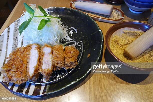 high angle view of tonkatsu served in plate on table - tonkatsu photos et images de collection