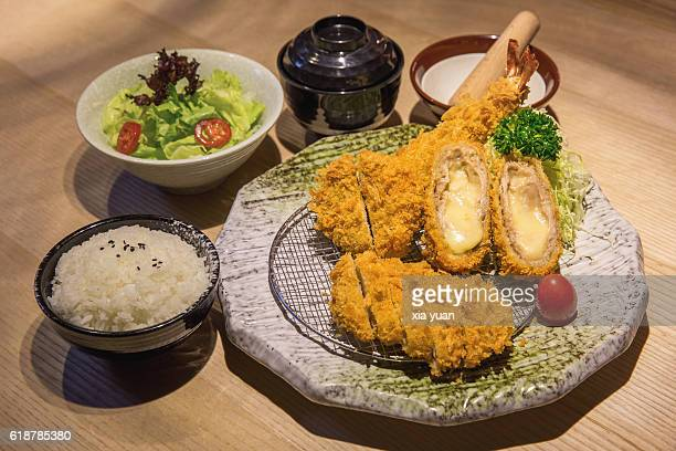 high angle view of tonkatsu with rice served on table - côtelette photos et images de collection