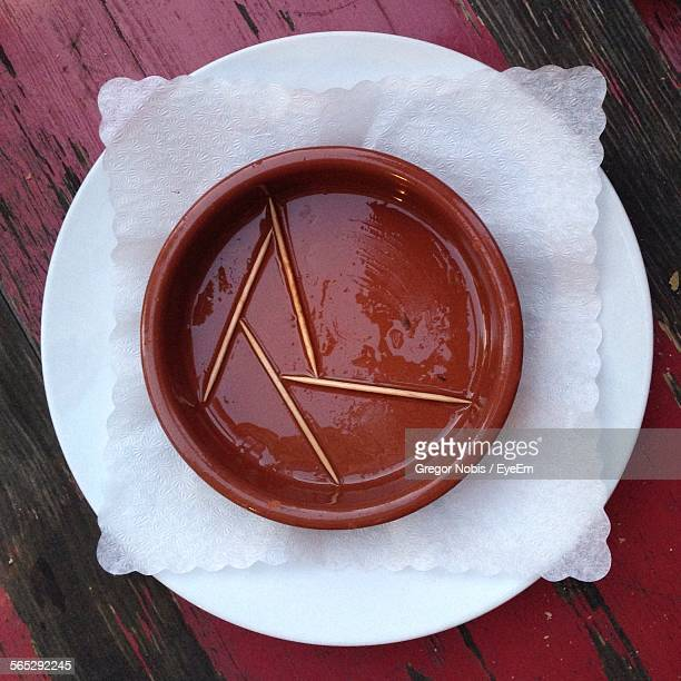 High Angle View Of Toothpicks In Bowl On Table