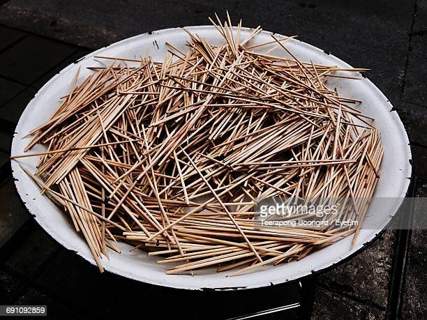 High Angle View Of Toothpicks In Plate On Table