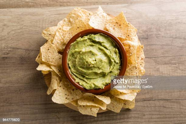 high angle view of tortilla chips on table - mexican food stock pictures, royalty-free photos & images