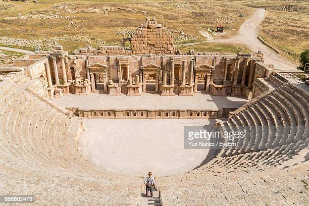 High Angle View Of Tourist Standing At Roman Amphitheater