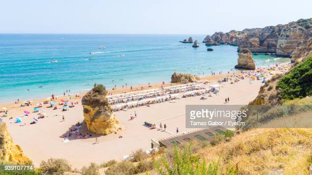 high angle view of tourists at beach - lagos nigeria stock photos and pictures
