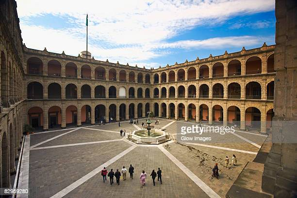 High angle view of tourists in the courtyard of a palace, National Palace, Zocalo, Mexico City, Mexico