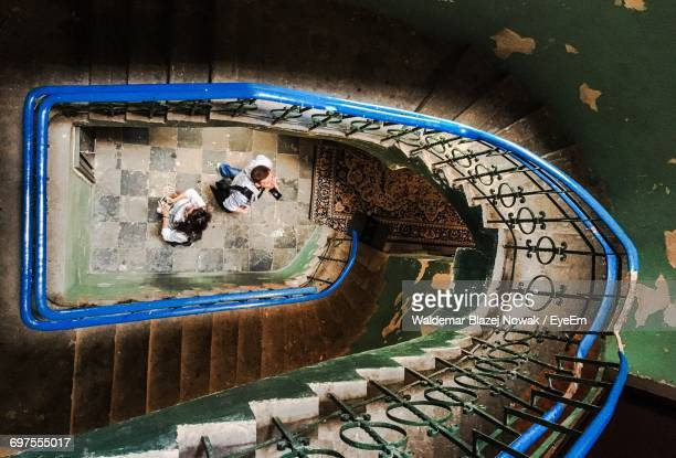 high angle view of tourists looking at steps in abandoned building - warsaw stock pictures, royalty-free photos & images