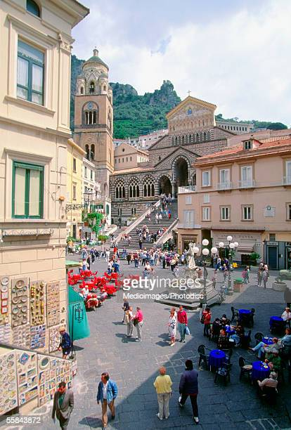 High angle view of tourists walking on a road near a cathedral, Amalfi, Italy