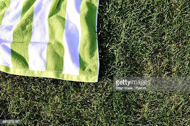 High Angle View Of Towel On Grassy Field