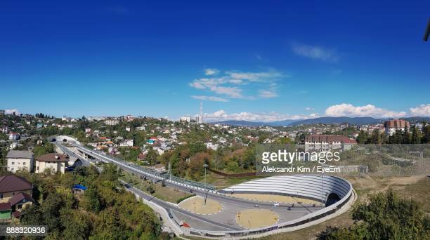 high angle view of town against blue sky - sochi stock pictures, royalty-free photos & images