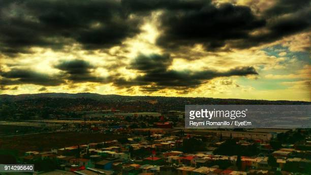 High Angle View Of Town Against Cloudy Sky