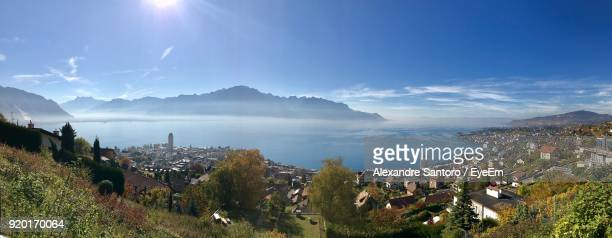 high angle view of town against cloudy sky - montreux stock pictures, royalty-free photos & images