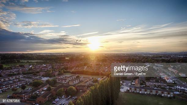 high angle view of town against sky during sunset - aylesbury stock photos and pictures