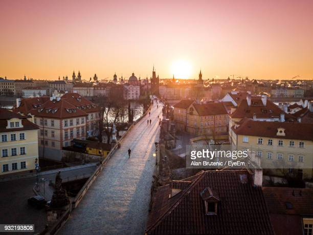 high angle view of town against sky during sunset - charles bridge stock photos and pictures