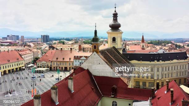 high angle view of town against sky - sibiu stock photos and pictures