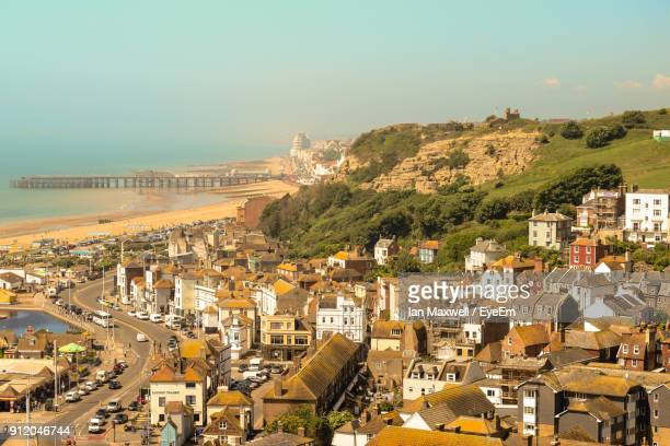 high angle view of town against sky - hastings stock photos and pictures