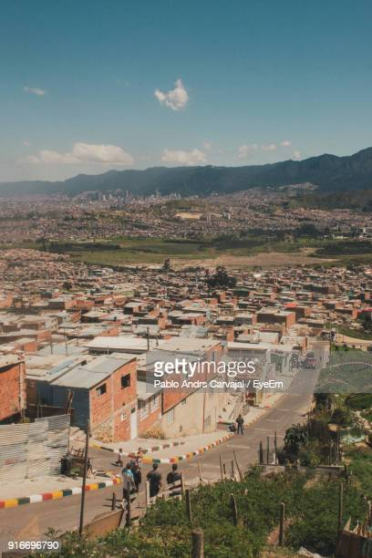 high angle view of town against sky - carvajal stock photos and pictures