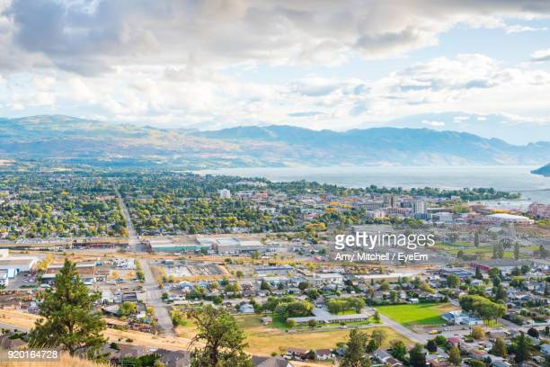 high angle view of town against sky - kelowna stock pictures, royalty-free photos & images