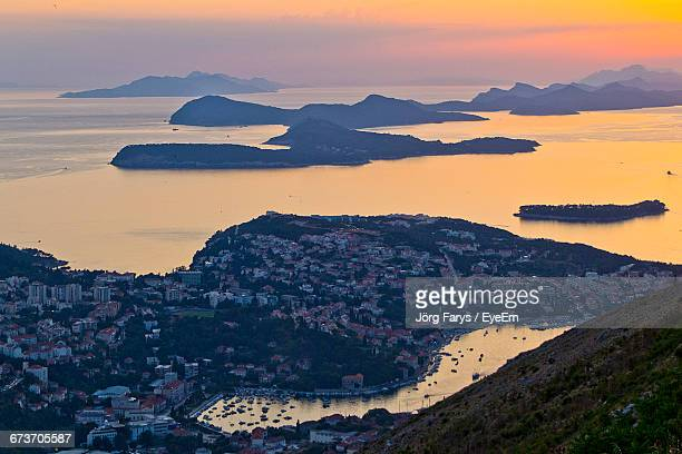 High Angle View Of Town And Adriatic Sea During Sunset