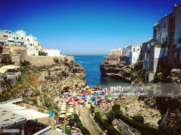 high angle view of town by sea against clear sky - bari stock photos and pictures