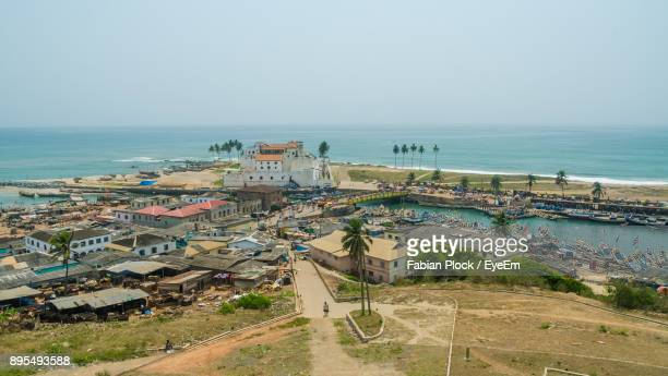 high angle view of town by sea against clear sky - ghana stock pictures, royalty-free photos & images