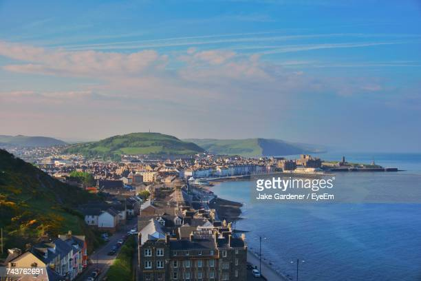 high angle view of town by sea against sky - west midlands stock pictures, royalty-free photos & images