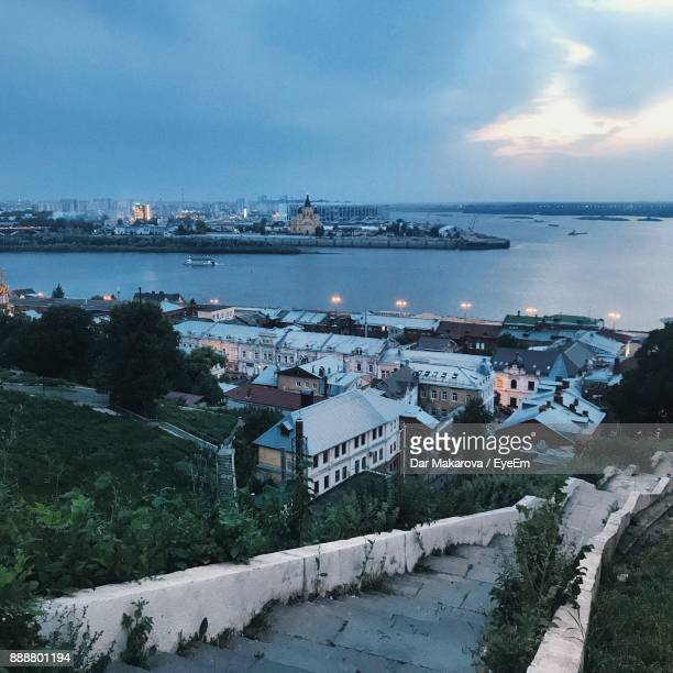high angle view of town by sea against sky - nizhny novgorod oblast stock photos and pictures