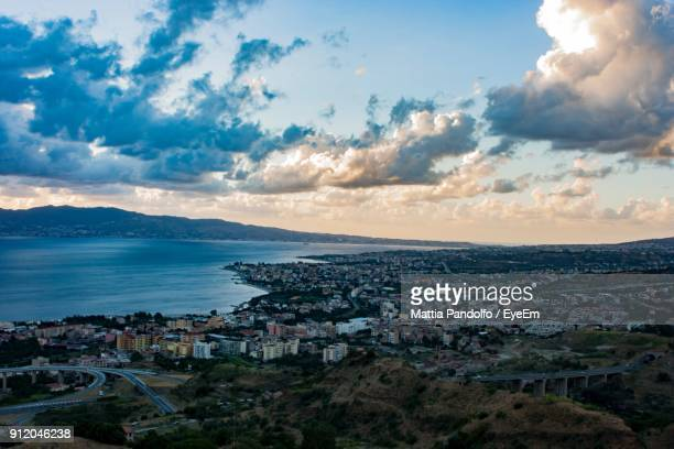 high angle view of town by sea against sky - reggio calabria stock pictures, royalty-free photos & images