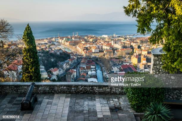 high angle view of town by sea against sky - rijeka stock pictures, royalty-free photos & images