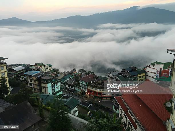high angle view of town in foggy weather during sunset - patna stock pictures, royalty-free photos & images