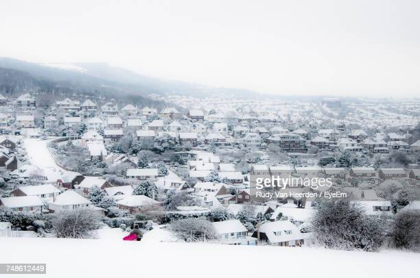 high angle view of town in winter - deep snow stock pictures, royalty-free photos & images
