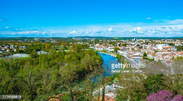 high angle view of townscape against blue sky - charente stock pictures, royalty-free photos & images