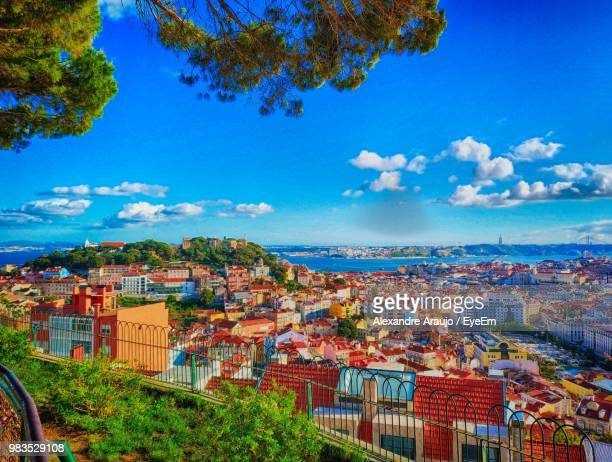 high angle view of townscape against blue sky - lisbon portugal stock pictures, royalty-free photos & images