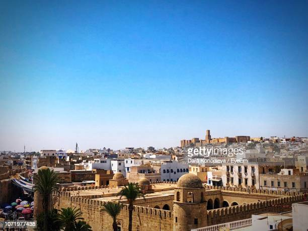 high angle view of townscape against clear blue sky - sousse stock pictures, royalty-free photos & images