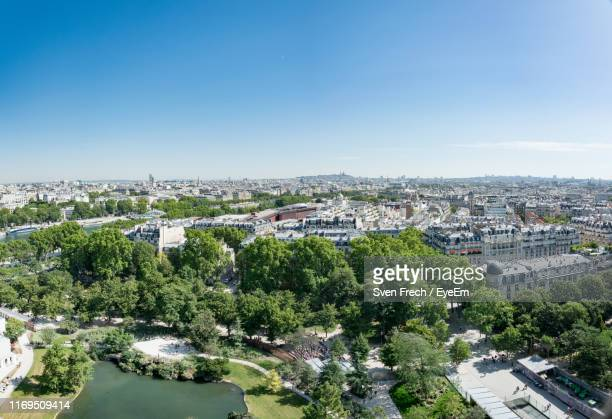 high angle view of townscape against clear blue sky - jour photos et images de collection