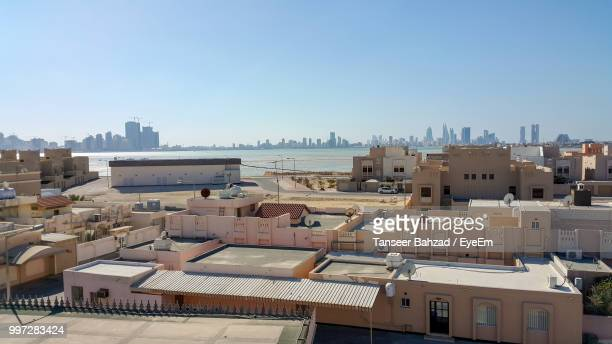 high angle view of townscape against clear sky - manama stock pictures, royalty-free photos & images