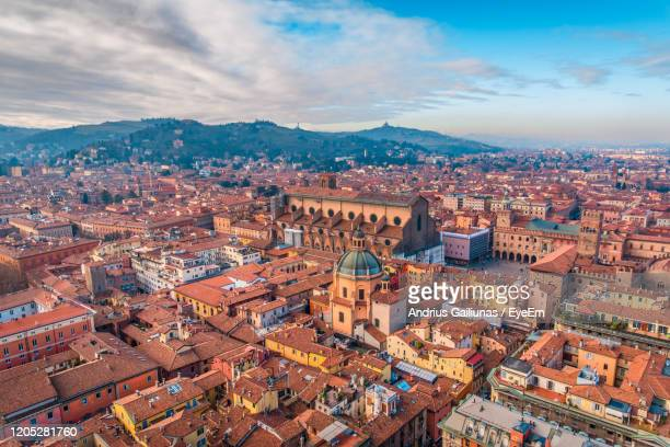 high angle view of townscape against cloudy sky - bologna stock pictures, royalty-free photos & images