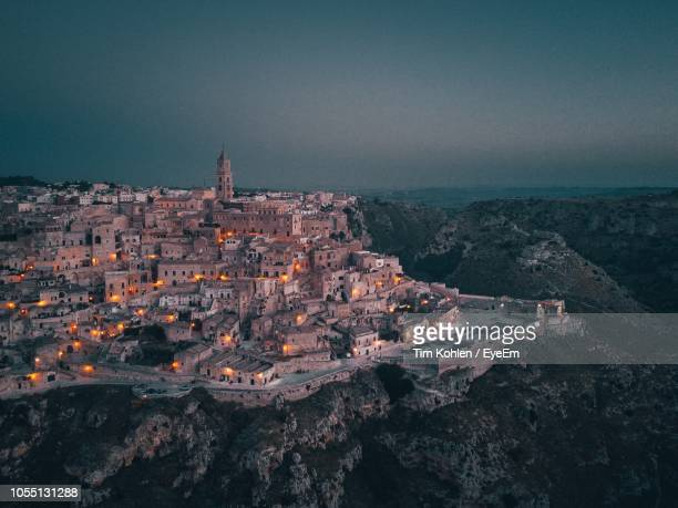 high angle view of townscape against sky at dusk - matera stock photos and pictures