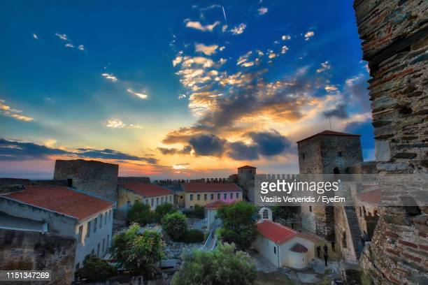 high angle view of townscape against sky at sunset - thessaloniki stock pictures, royalty-free photos & images