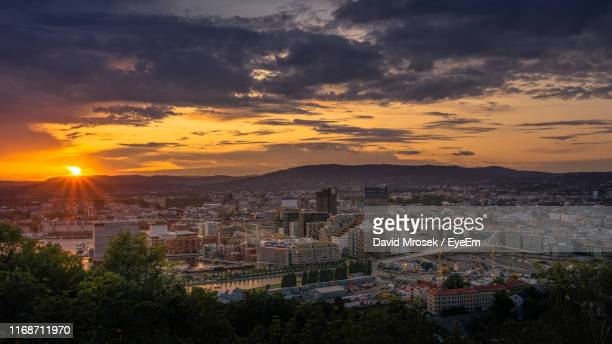 high angle view of townscape against sky at sunset - oslo stock pictures, royalty-free photos & images