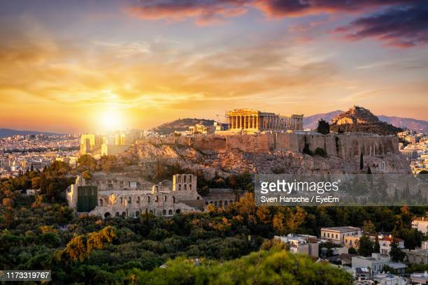 high angle view of townscape against sky at sunset - athènes photos et images de collection